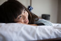Smiling girl resting on bed Royalty Free Stock Photo