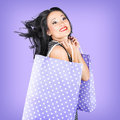 Smiling girl shopper holding purple shopping bags fashion rush in sale Stock Images
