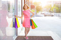 Smiling girl with shopping bags background showcase Stock Photo