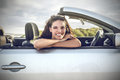 Smiling girl sitting in a car Royalty Free Stock Photography