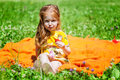 A smiling girl is sitting on the meadow Stock Photography