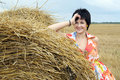 Smiling girl at a stack of straw Stock Photo