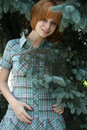 Smiling girl standing near fir-tree Stock Photography