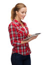 Smiling girl with tablet pc computer technology internet and people concept Royalty Free Stock Photos