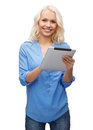 Smiling girl with tablet pc computer technology internet and people concept Stock Image