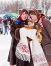 Smiling girl tasting pancake during shrovetide at russia Royalty Free Stock Images
