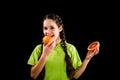 Smiling girl tasting sliced red grapefruit Royalty Free Stock Photo