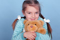 Smiling girl with teddy bear Royalty Free Stock Photo