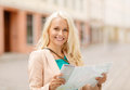 Smiling girl with tourist map in the city holidays and tourism concept beautiful Royalty Free Stock Photo