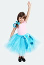 Smiling girl in tutu skirt hand up studio shot Royalty Free Stock Photography