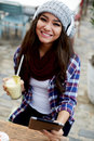 Smiling girl using digital tablet sitting in cafe Royalty Free Stock Photo