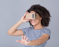 Smiling girl using virtual reality device Royalty Free Stock Photo