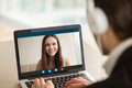 Smiling girl on video call with guy, virtual chat online Royalty Free Stock Photo