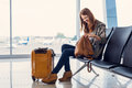 Smiling girl waiting for boarding Royalty Free Stock Photo
