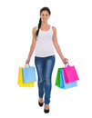 Smiling girl walking with shopping bags Royalty Free Stock Photo