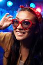 Smiling girl wearing heart shaped glasses at party Stock Photo