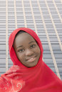 Smiling girl wearing a red headscarf in the street, thirteen years old Royalty Free Stock Photo