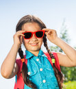 Smiling girl wearing sunglasses with two braids portrait in summer Royalty Free Stock Photography