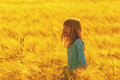 Smiling girl in the wheat field cute standing middle of Royalty Free Stock Photo