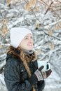 Smiling girl in a white hat with cup of tea. Winter, outdoors. S Royalty Free Stock Photo