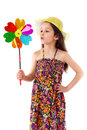 Smiling girl with windmill Royalty Free Stock Photos