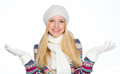 Smiling girl in winter clothes catching snow isolated on white Royalty Free Stock Image