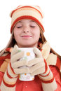Smiling girl in winter clothes holding cup of tea young with pigtails Royalty Free Stock Image