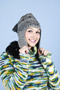 Smiling girl in wool cap and pullover Royalty Free Stock Image