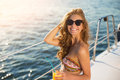 Smiling girl on yacht.