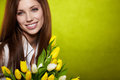 Smiling girl with yellow tulips. Royalty Free Stock Photo