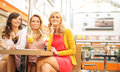 Smiling girlfriends enjoying their dessert sweet Royalty Free Stock Photos