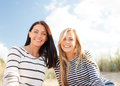 Smiling girlfriends having fun on the beach summer holidays vacation happy people concept Royalty Free Stock Images