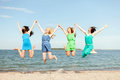 Smiling girls jumping on the beach summer holidays and vacation concept Stock Image