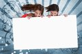 Smiling girls looking down at white copy space screen on blue art deco style background Stock Photo