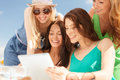 Smiling girls looking at tablet pc in cafe Stock Photos