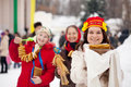 Smiling girls  with pancake during  Shrovetide Stock Photography