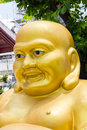 Smiling golden buddha statue chinese god of happiness wat aru arun bangkok Royalty Free Stock Photography