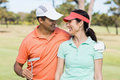 Smiling golfer couple with arm around Royalty Free Stock Photo