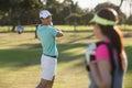 Smiling golfer man looking at woman Royalty Free Stock Photo