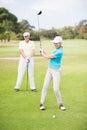 Smiling golfer woman taking shot Royalty Free Stock Photo