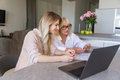 Smiling granddaughter and her grandmother shopping online Royalty Free Stock Photo