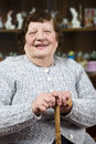 Smiling grandma with stick Royalty Free Stock Photos