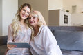 Smiling grandmother and her granddaughter looking camera Royalty Free Stock Photo