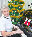 Smiling granny play to piano Stock Photography