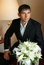 Smiling Groom holding a bouquet Royalty Free Stock Photos