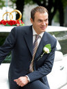 Smiling Groom on wedding Car limousine Stock Photography