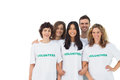 Smiling group of volunteers standing on white background Royalty Free Stock Image