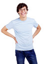 Smiling guy with arms akimbo laughing latin young man in glasses and blue shirt hands on hips isolated on white background mask Royalty Free Stock Photos