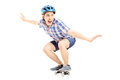Smiling guy with helmet skating on a skate board isolated white background Stock Photos