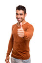 Smiling guy showing thumbs up over white background Royalty Free Stock Photos